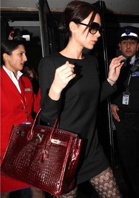Виктория Бекхэм с сумкой Биркин из крокодиловой кожи